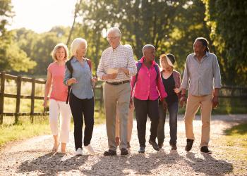seniors standing in wooded area